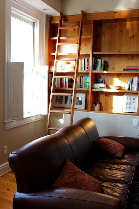 Leather pull-out sofa converts to queen sized bed for extra guests. Take a book, leave a book from the built-in bookcase!