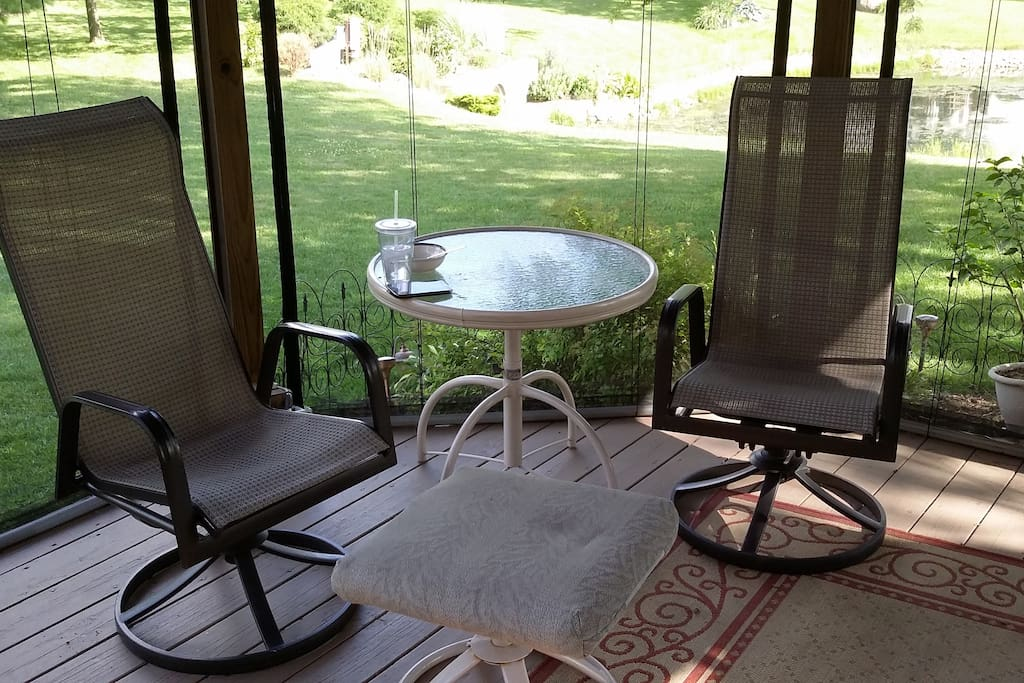 The screened in gazebo  with a view of the lake.