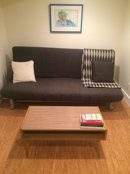 Futon in living space for extra pals. We can make up the bed upon request