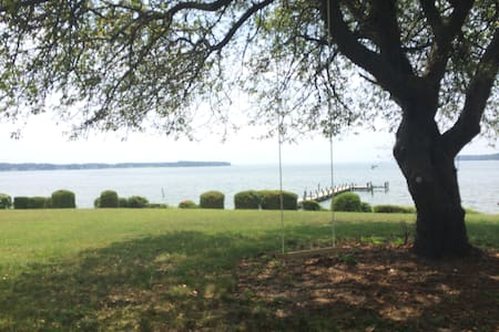 This is a great spot on Breton Bay, offering sweeping views of the water from its shady porch, expansive sunny yard or from the long dock in front. The home was recently rebuilt from the ground up and is entirely new.