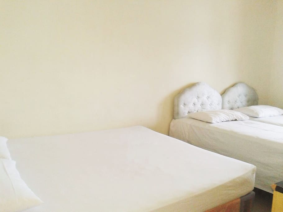 1 King-size bed and 2 single beds with wardrobe. Second floor. Suitable for family or group.