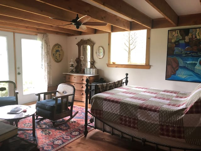 Your full bedroom, sitting area and luxury bathroom suite. Beautiful views, real art, antiques and lots of natural light.