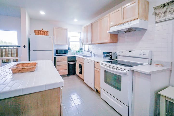 Well equipped kitchen with dishwasher, toaster oven, coffee maker, tea pot, blender, microwave, dishes, glass ware, silverware, napkins, basic condiments and spices, paper towels and trash bags, dish-washing liquid, trash bags, dishwasher soap.