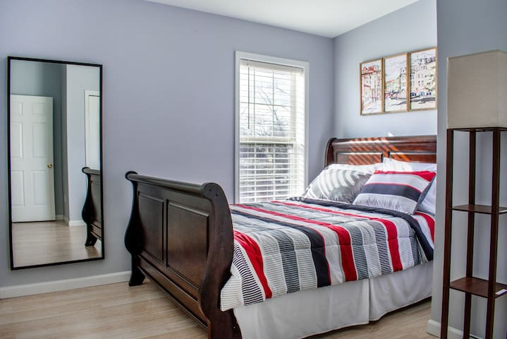 Third bedroom with queen   bed (sleeps 2); closet with iron/board