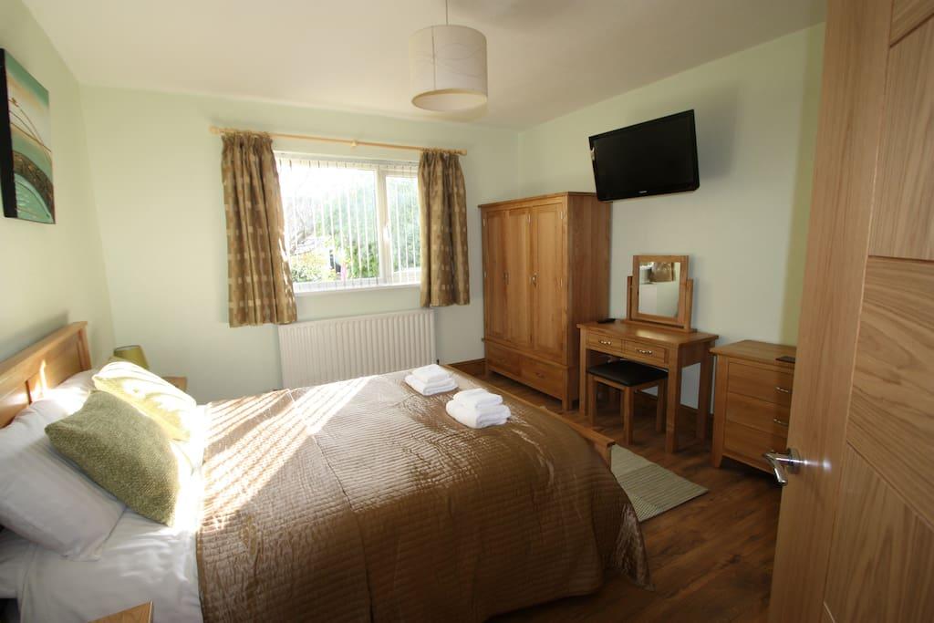 Master bedroom with Tv/ Oak furniture triple wardrobe, ensuite shower, hairdryer