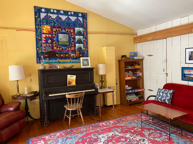 The piano isn't in tune, but is fun to play anyway. This room has a full size futon couch.