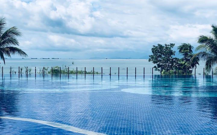 (下楼即游泳海滩)十里银滩/小径湾 无边际泳池+免费停车 一线海景公寓