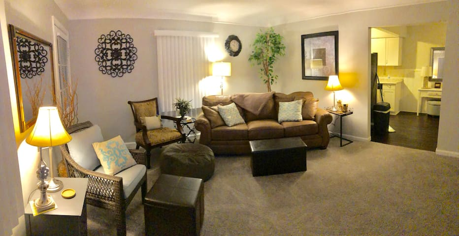 """LIVING ROOM Very spacious!Plenty of seating to relax & catch a game or movie on the 55"""" Smart TV.  Queen sofa-bed, w/Memory Foam mattress.  LR access to the balcony too."""