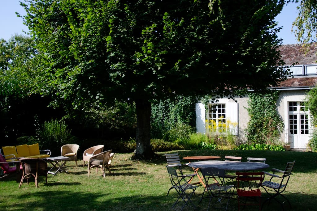 Large garden composed of several charming different jardins all around the house, with outdoor furniture.
