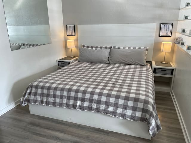 King sized bed for two. The side table lamps have USB ports for an easy spot to charge your electronics.