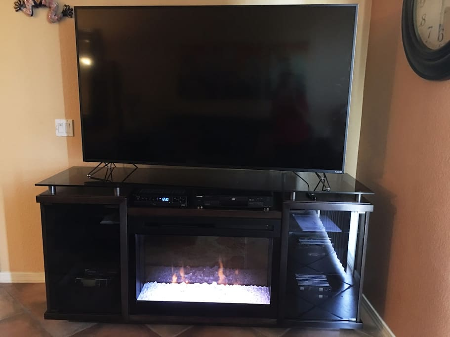 "70"" TV with fireplace"