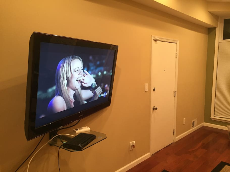 60 inch screen television in living room with cable.