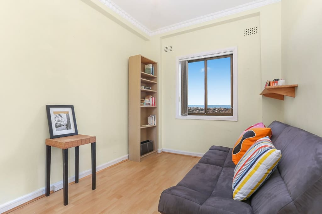 Guest bedroom with view to Bondi and  the horizon (built in wardrobe too).