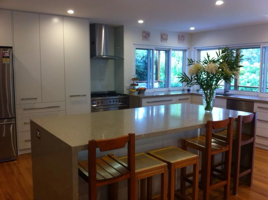 Large kitchen with appliances, coffee machine smeg upright cooker, microwave, large fridge with ice & water dispenser