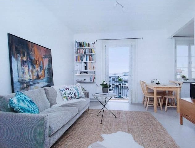 Spacy living room with wooden floor.