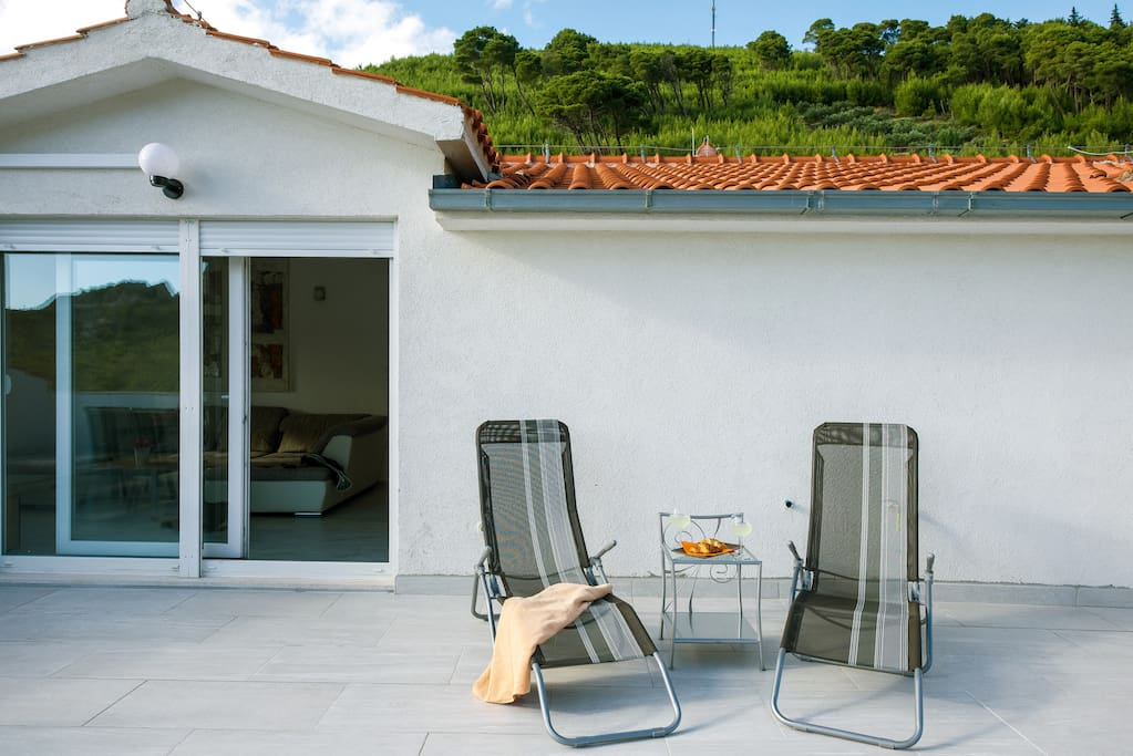 Terrace with sun loungers