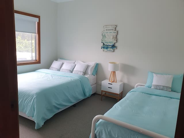 Second bedroom. Queen size bed and single bed
