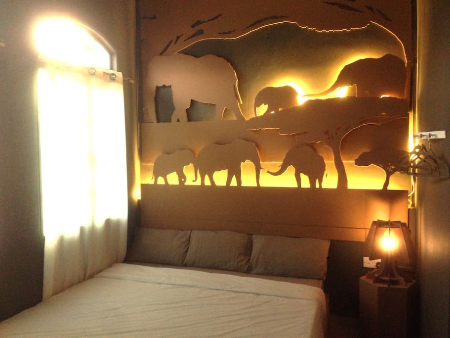 Elephant deco with background lighting had create a state of great comfort and extravagant environment in this room