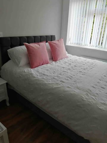 King size bed with charging station for your mobile devices
