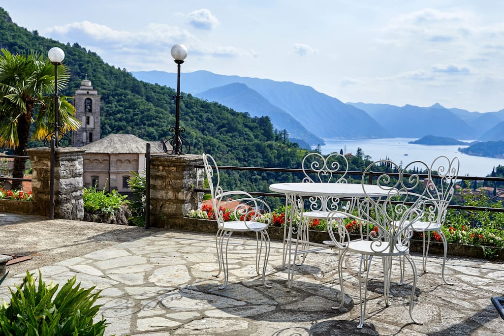 table and chairs for dining in the open, beautiful garden with orchard, villa of 900
