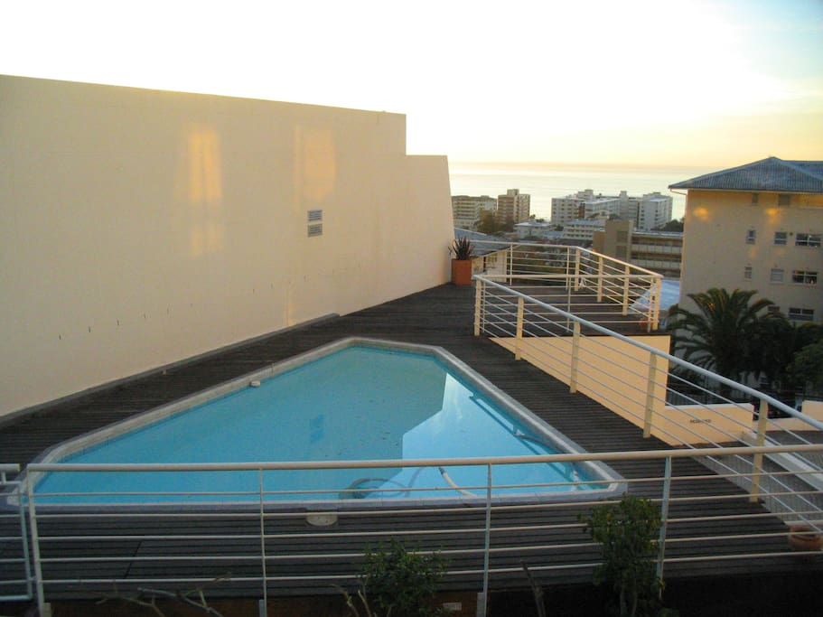 Refreshing swimming pool with ocean view. Perfect for cooling down or sunbathing on long, hot summer days.