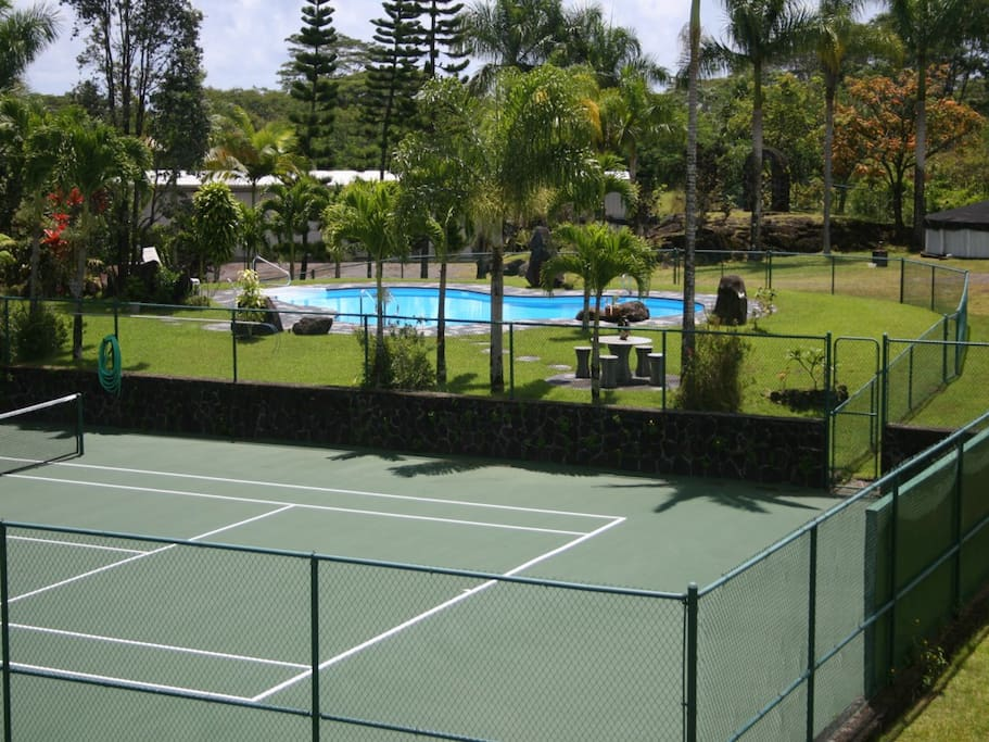 Private regulation tennis court and saline pool