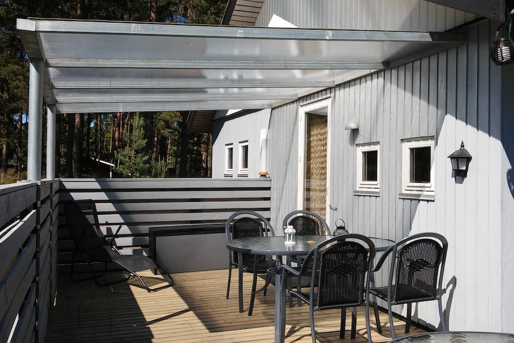 The patio has two sets of garden furniture and sunbeds.