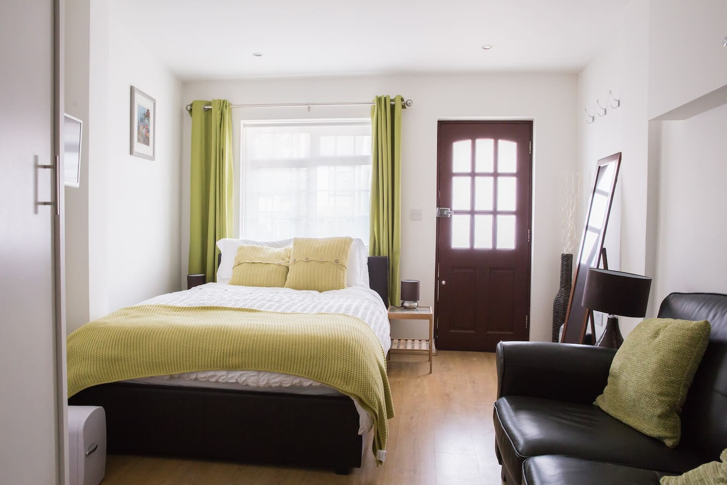 A home from home in Mill Hill... Double ottoman bed, comfy sofa, extensive storage and hanging space in large double wardrobe.