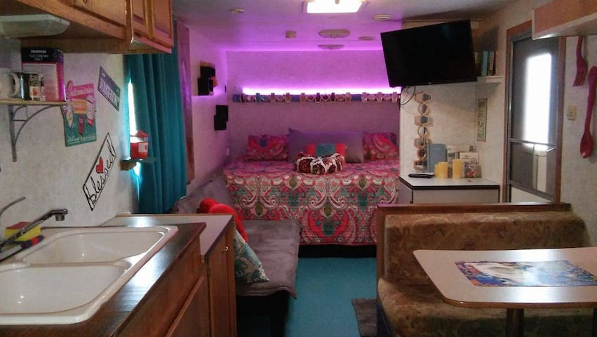 King bed and mood lighting :) and private full bath, has two bunks in rear 32 foot Glamper