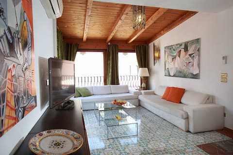 Living room on the 5th floor with great views on Mount Etna and the old town of Taormina