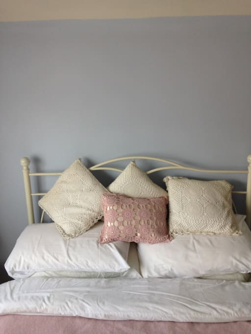 A comfortable double bed with linen provided.