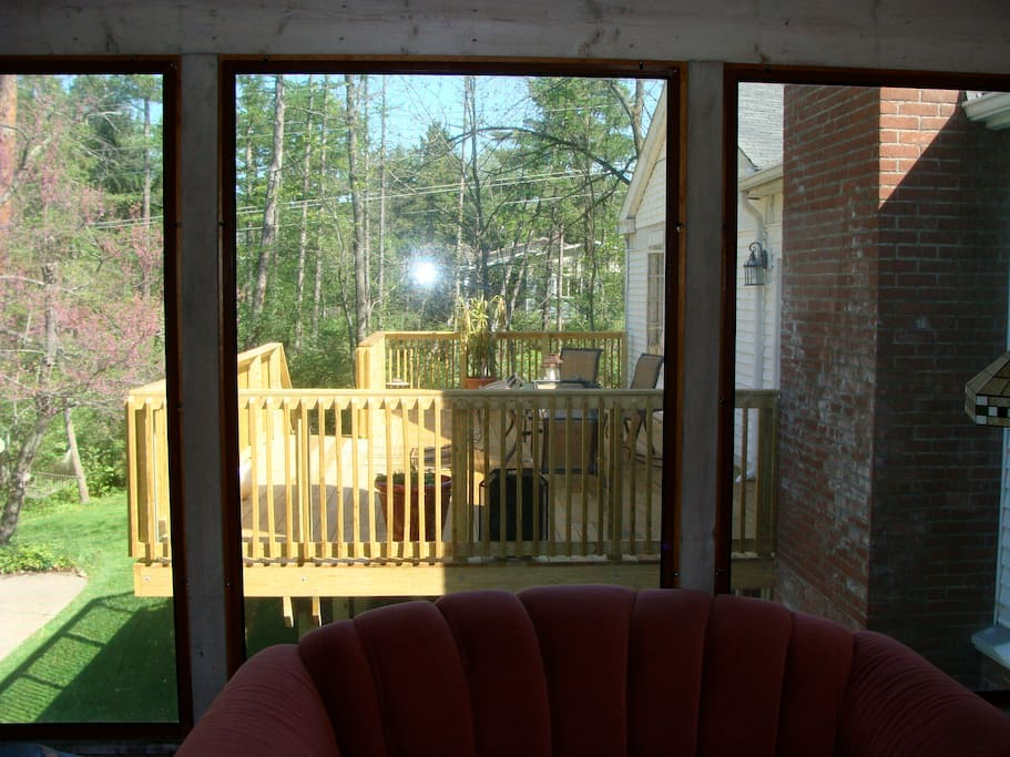 The view from the screened in porch over to the deck.
