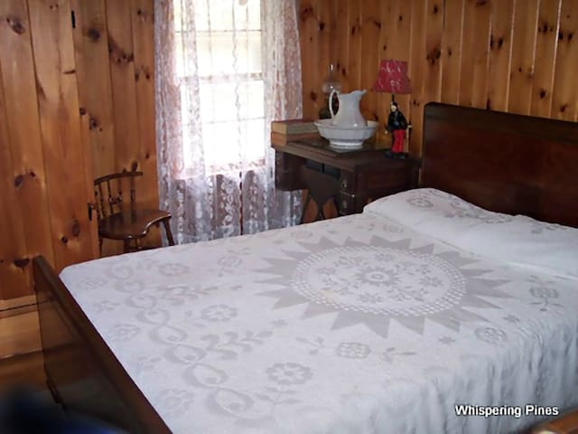 The Forest View bedroom with traditional vintage decor does not get early morning sun.