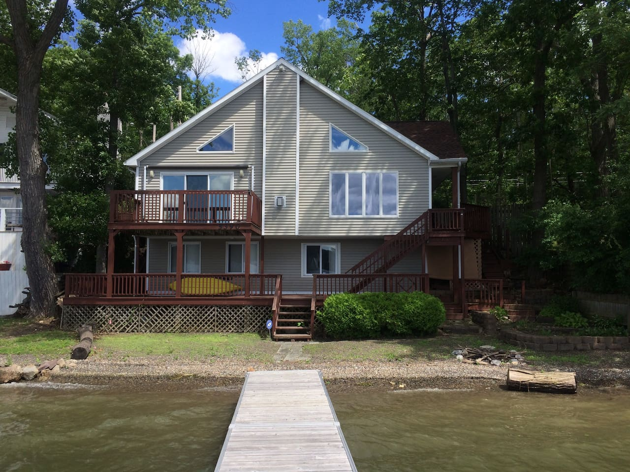 Beautiful Contemporary A-Frame.  Spacious open floor plan that all overlooks the lake!  Great for entertaining!  Walk out to the deck.  The lower level is partially finished w/add'l bedroom, bonus room & 1/2 bath.  Dock and natural beach.