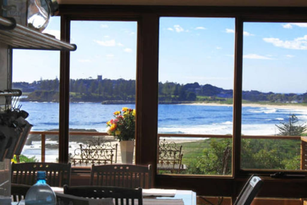 View of Moreheads beach from kitchen looking over dining table
