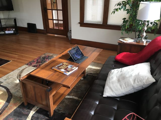 Enjoy the coffee table, it converts into a computer work place. How cool!