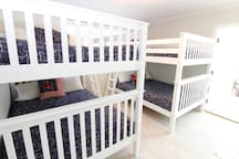 Bunk room downstairs with 2 Full over Full large bunks, sleeps 8. Fits adults and kids with high end memory foam mattresses.