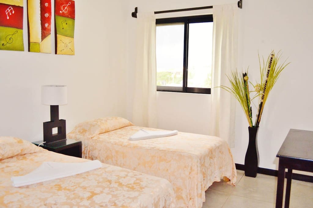 Two bedrooms with queen bed or two single beds