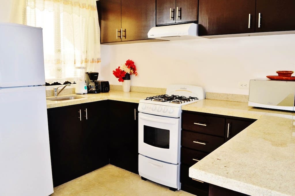 Fully equipped kitchen with stove.