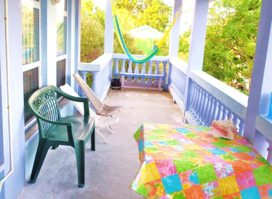 Upstairs outside porch with table, chairs and hammock