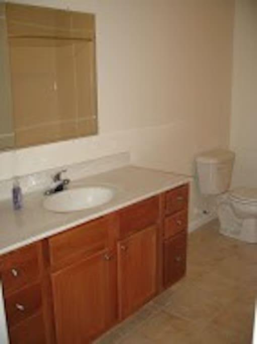 Bath with ceramic tile.  Large bath room