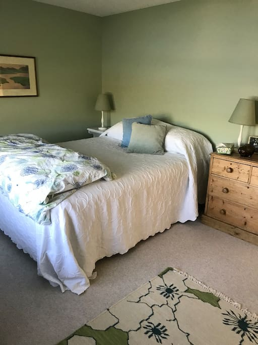 Bedroom 4 with queen bed and view of the lake.