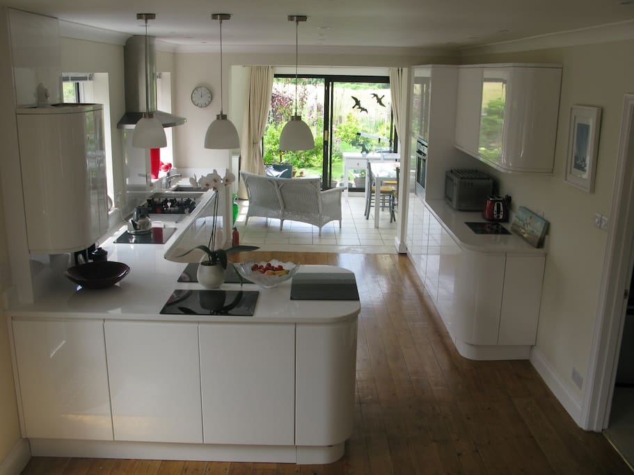 Open plan hall, kitchen, leading to sunroom and decking