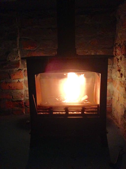 Cast iron wood-burning fireplace for those chilly winter's evenings