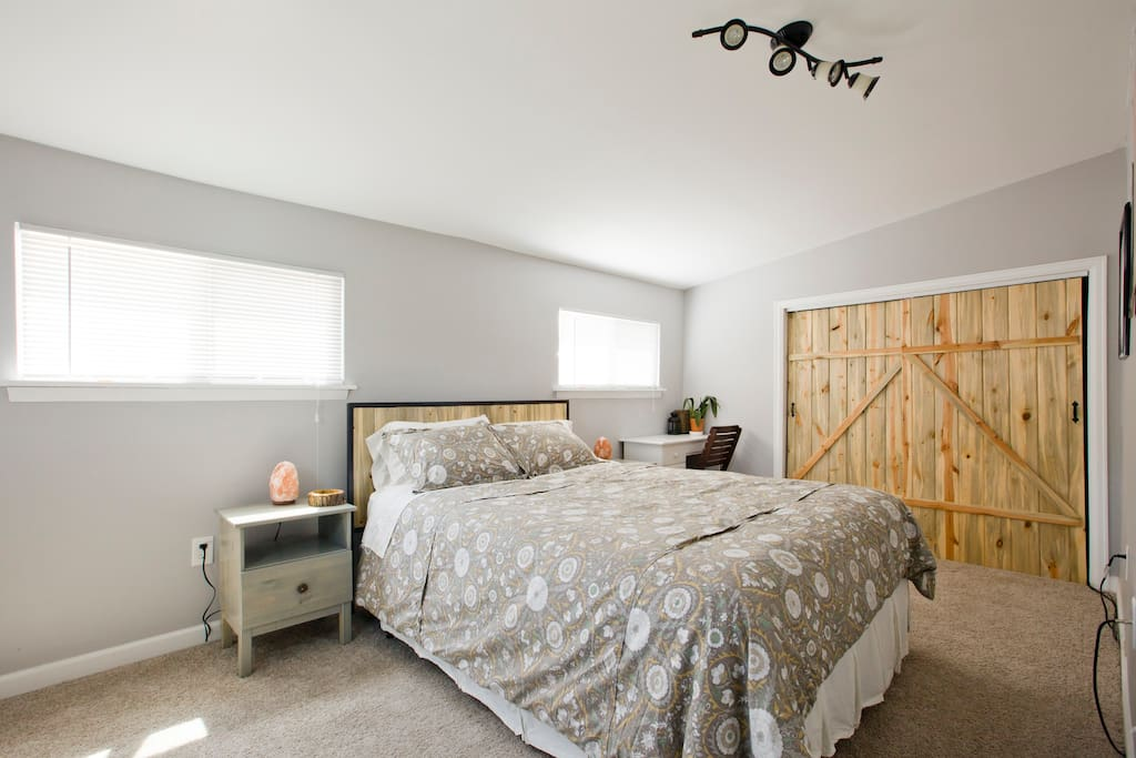 Queen bed, air-cleaning salt lamps, hand made bed frame and barn doors from Colorado beetle kill pine
