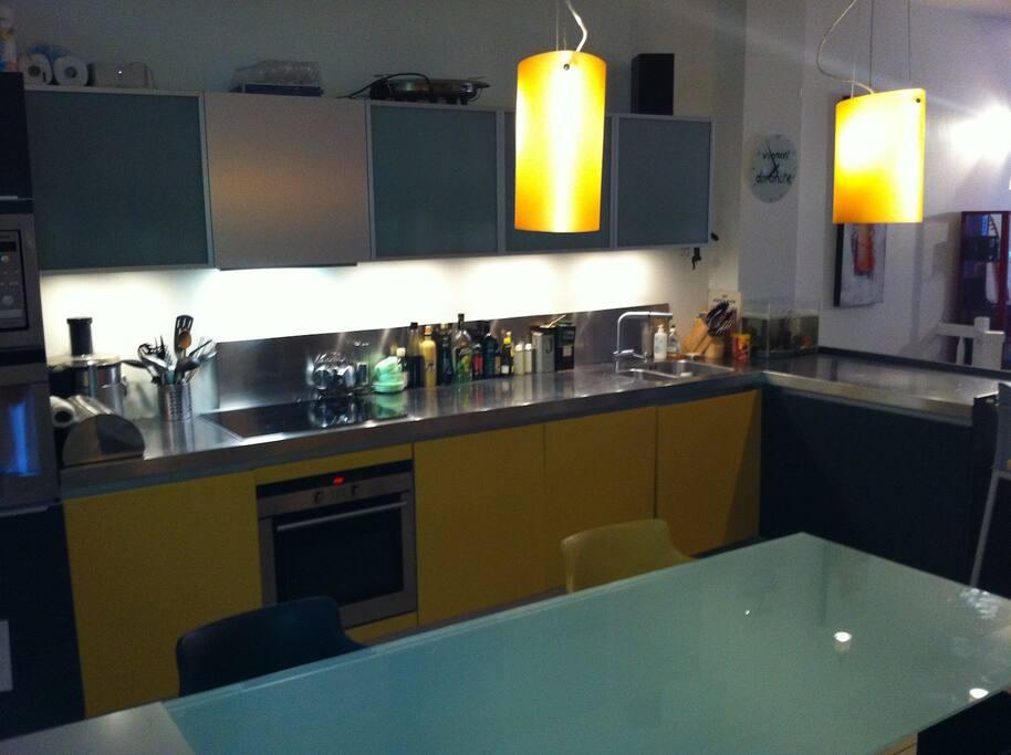 modern kitchen with built-in wall espresso machine, wash machine and dishwaster machine