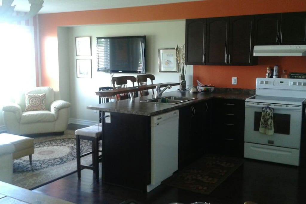 Fully loaded kitchen and use of living room for your comfort and use.
