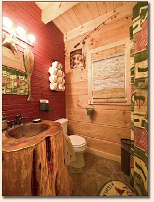 The full bathroom has a shower tub so you can take a leisurely bath or shower. The sink base was made from a tree stump and the top is made of copper. All bath towels and wash clothes are provided.