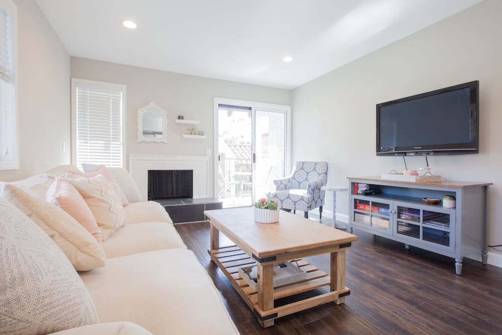 Gorgeous, comfortable living room. Flatscreen TV is equipped with an Amazon Firestick so you can watch all of our favorite movies and television shows on Hulu, Netflix, and Amazon.