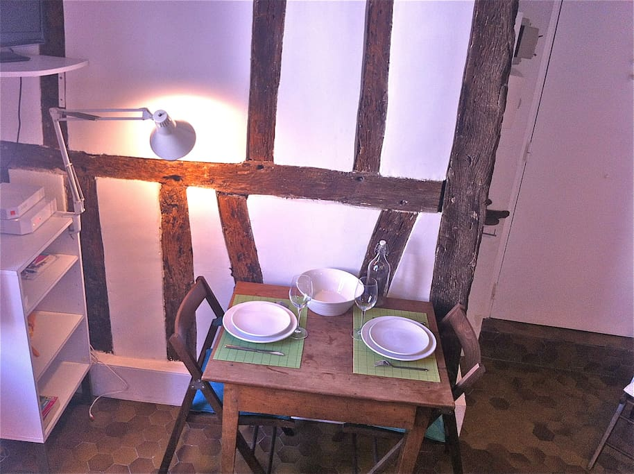 Main room - Table and wall with exposed beams